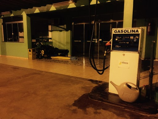 Sleeping on petrol station forecourt, Paraná, Brazil