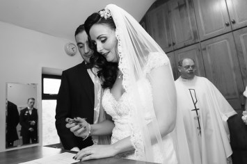 Signing the book   Wedding Photography by Paul McGlade