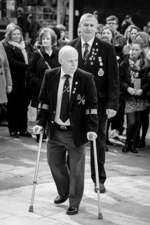 Veterans pay their respects during the ceremony