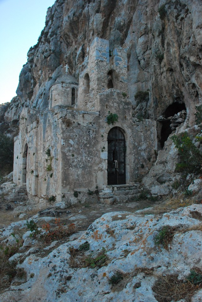 The entrance to a cave can be seen behind the church. Photograph: Paul Nettleton