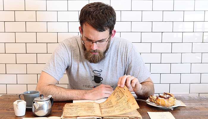 Photo of NBaltzersen's owner The Cafe Guy Paul Rawlinson reading his Great Grandma's recipe book.