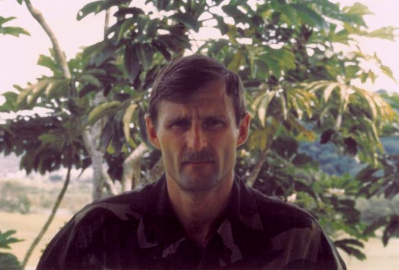 Paul Shemella in fatigues in jungle