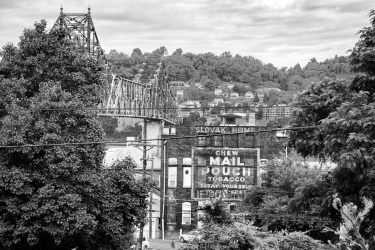 Condemned Bridge across the Ohio River and a tobacco sign.