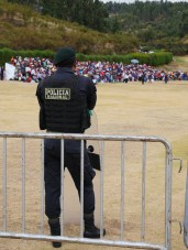 Riot police watch over activities in case of trouble.