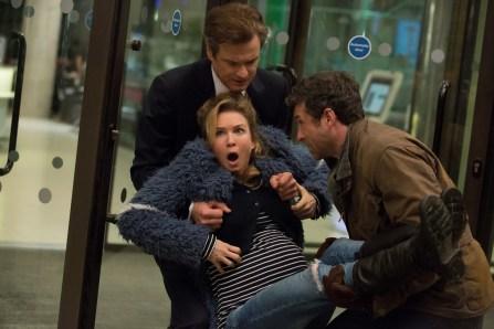 Bridget (Renée Zellweger) im Arm von Mark (Colin Firth, l.) und Jack (Patrick Dempsey, r.)