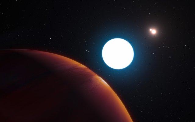 Umetnikovo viđenje gasnog giganta HD 131399Ab, koji pripada sistemu trostrukog sunca, 320 svetlosnih godina udaljenoog od Zemlje. Ilustracija: Luís Calçada