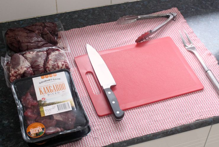 knife chopping board raw meat and organs