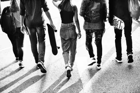 grayscale photography of five friends walking together
