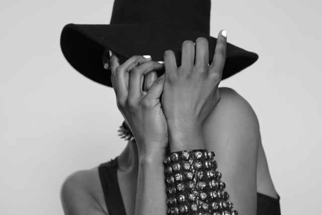 woman wearing hat covering her face