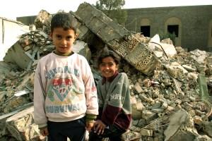 Kids by rubble in Iraq
