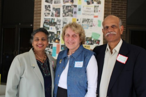 Joan Tirak, outgoing Pax Christi Michigan state coordinator, with Doreen and Neville D'Souza.