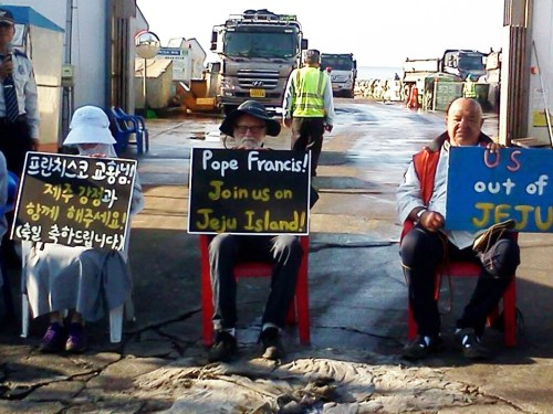 Pax Christi Pacific Northwest icon Fr. Bill Bichsel protests at Jeju Island.