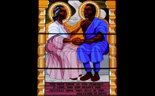 St. Augustine and his mother, St. Monica, are depicted in a stained-glass window at St. Augustine Church in Washington. (CNS/Bob Roller)
