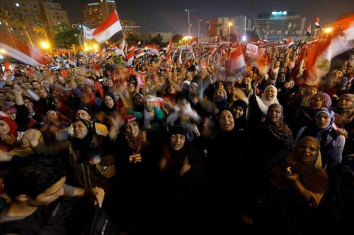 Egyptian protesters shout slogans against Egyptian President Mohammed Morsi as they watch his speech at Tahrir Square, the focal point of Egyptian uprising, in Cairo on June 26, 2013. (Flickr/AP Photo/Amr Nabil)