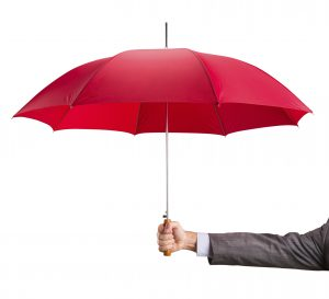 Businessman hand with an red umbrella isolated on white