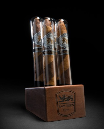 This unique presentation is constructed from fine exotic hardwoods and includes (4)cigarsencased in glass.