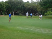 One of the golf teams putting at Hole 14