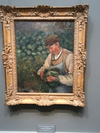 The Gardener - The Old Peasant with Cabbage by Camille Pissarro
