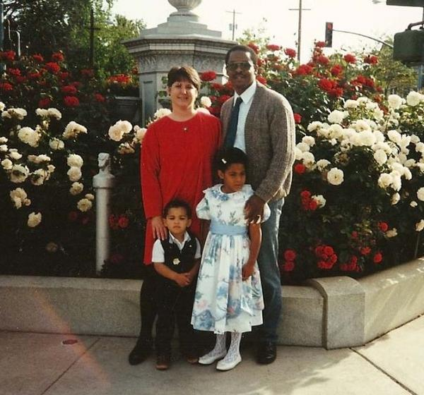 The first time I was transferred under the foster care system. My foster parents and sister, shown here, eventually adopted me into their family. I was very fortunate.
