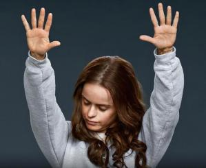 Image result for girl from oitnb with raised hands