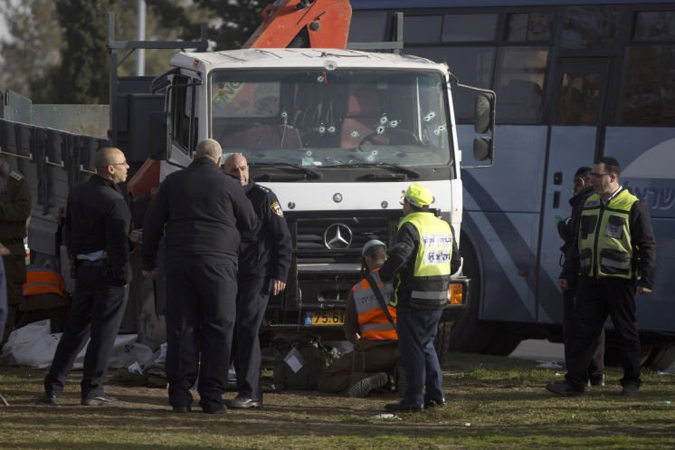 Police: Palestinian drives truck into Israeli soldiers, killing four, in Jerusalem