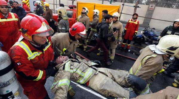 Photos: firefighters overcome with emotion as colleagues ...