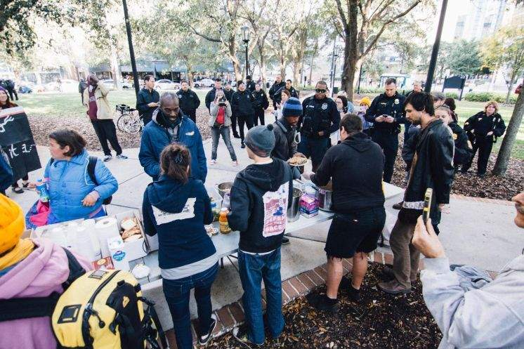 Criminal charges dropped against people who were sharing food with homeless in public park.