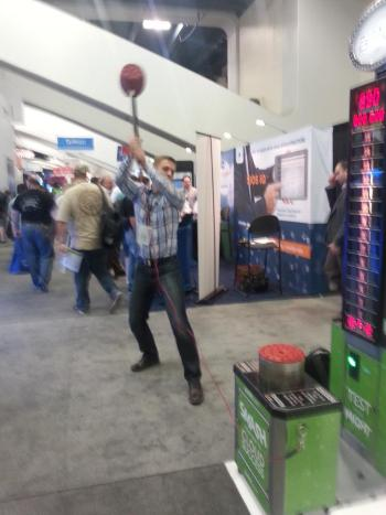 VMworld attendees playing carnival game at AirVM booth.
