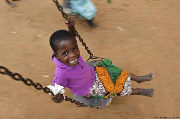 Swinging into the weekend! A girl smiles at a child care ...