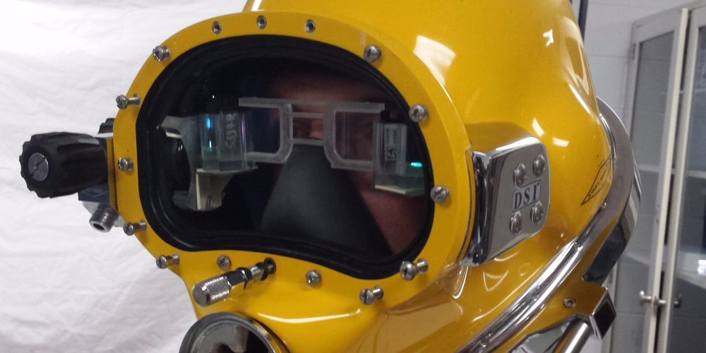 The US Navy created a futuristic diving helmet that gives divers Ironman-like vision