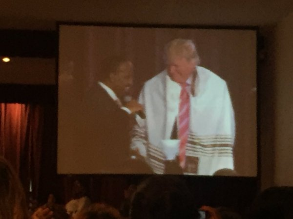 Donald trump is presented with a prayer shawl at great ...
