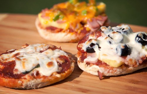 Make TASTY campfire grilled pizzas using English muffins: �