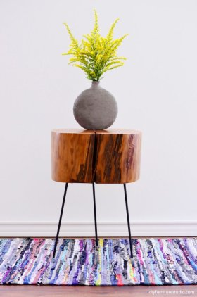 DIY project for under $100: Make a tree stump side table with tripod legs.