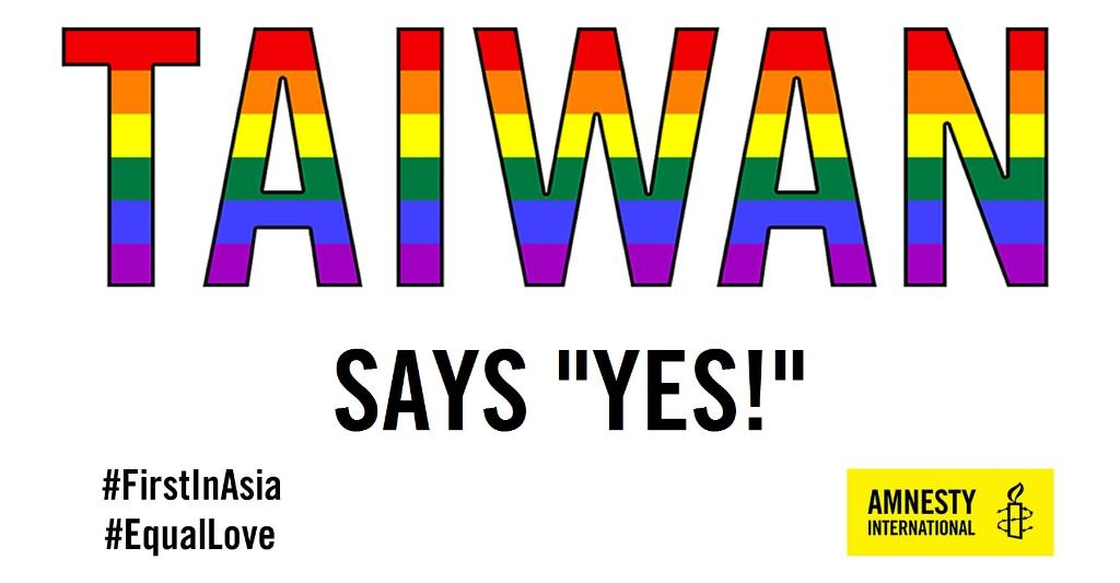 """Image is text. Taiwan in large font against a white backdrop. The colors of the rainbow flag fill in the name of the country. Under Taiwan appears ' Says """"Yes!"""" ' Lower left appears to hashtags: FirstInAsia and EqualInLove Amnesty International logo appears in bottom right."""