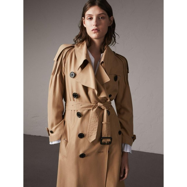 An oversize @Burberry trench coat with ruffle detail. Shop the look...