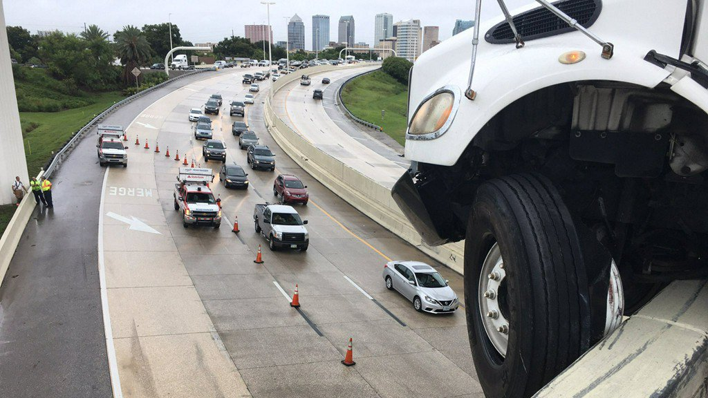 Big rig cab hanging off I-4 ramp to I-275 causing traffic nightmares