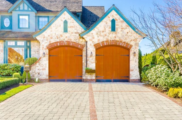 These non-traditional garage doors are called carriage doors, and they're a...
