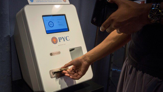 Woman seen feeding cash into Bitcoin ATM was scammed, police say