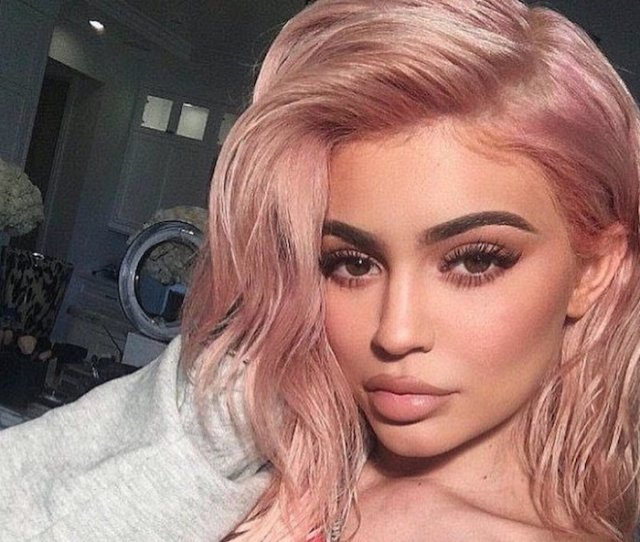 Kylie Jenner Posts String Of Sultry Selfies But Keeps Her Baby Bump Covered Up