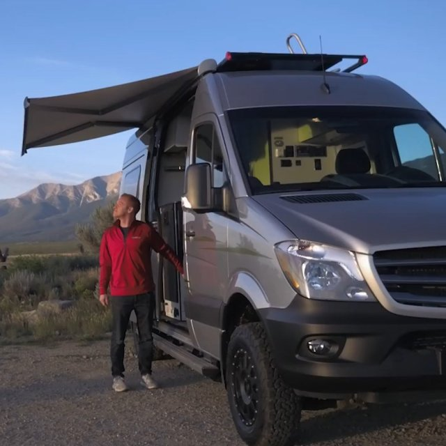 This RV is fully equipped with roof-mounted solar cells that power the...