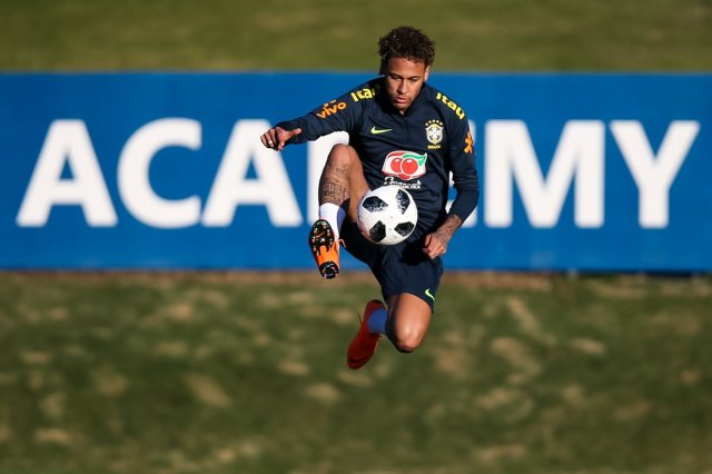 Neymar trains with Brazil on 22 May.