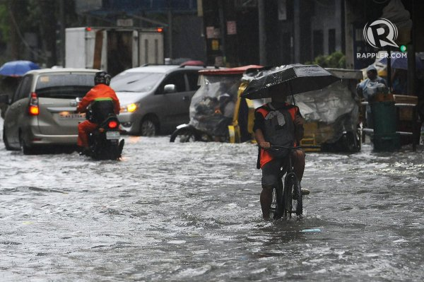 Commuters and motorists brave the flooding at various ...