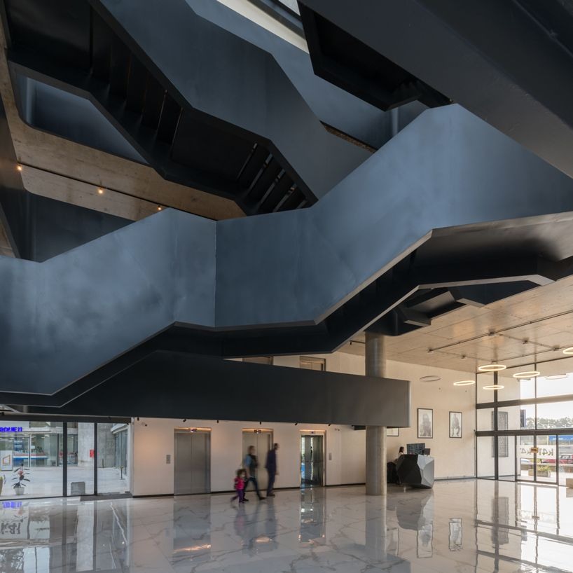 The largest platform for products, materials and concepts for designers and architects. Designboom On Twitter The Central Hall Of This Buenos Aires Office Is Filled With An Overlapping Ribbon Of Staircase Https T Co Rvq8v9ops0 Https T Co Bv40kew2up