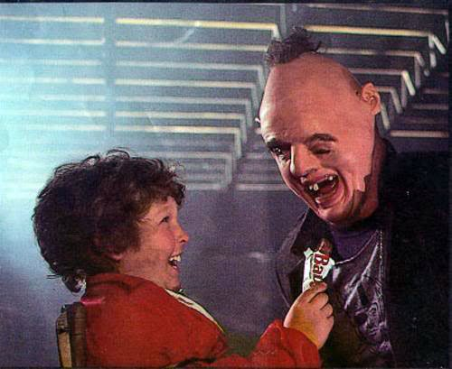 """In the movie """"The Goonies"""" what brand of candybar did Chunk try to give to..."""