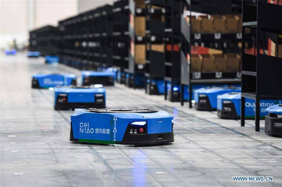 test Twitter Media - #ChinaTech: #Robots carry goods at a warehouse in the Cainiao Future Park in Wuxi City, east China's Jiangsu Province, Nov. 8, 2018. Some 700 intelligent robots work at the warehouse, whose working efficiency has  been increased 1.5 times. https://t.co/9R1H8VIfPG