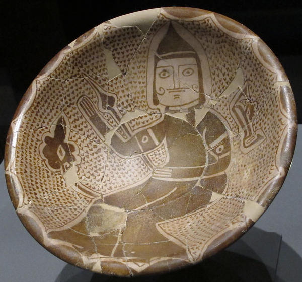 A man possibly holding a weapon and wearing a helmet. Abbasid Caliphate. Lustreware Bowl (Figural), Abbasid, Iraq (Samarra), 9th century. Qatar Museum of Islamic Art - photo by nicolaoutdoors -