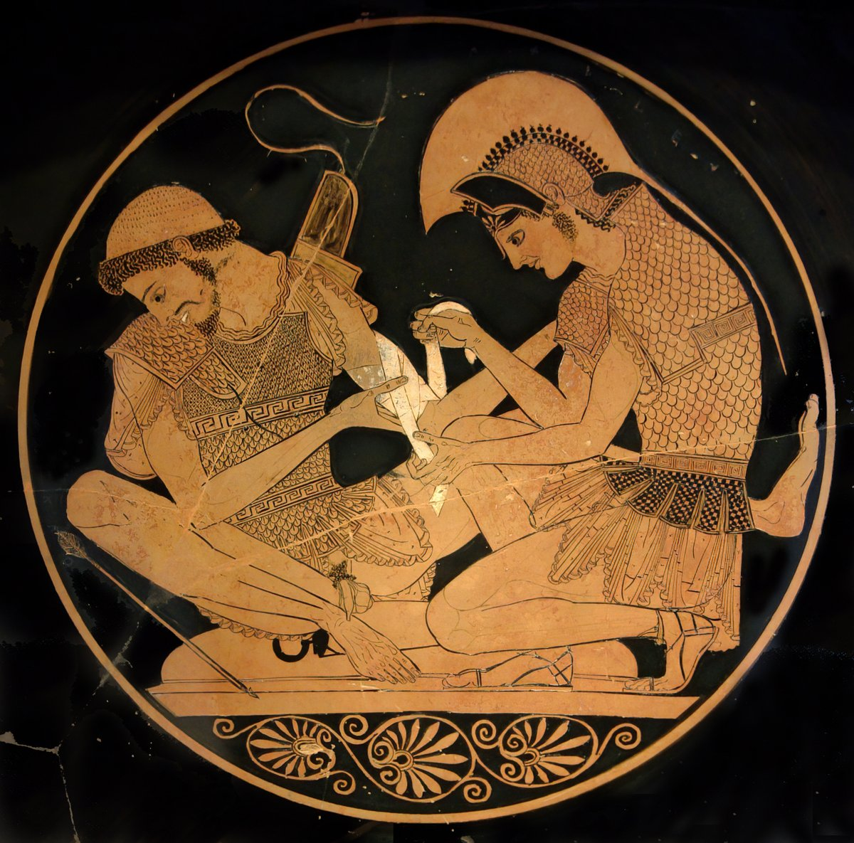 Achilles heals Patroclus, since he learned the arts of medicine from his tutor, Chiron. Both men are believed to be wearing linothoraxes.[citation needed] attic red-figure kylix, signed by Sosias, c. 500 BC, Antikensammlung Berlin