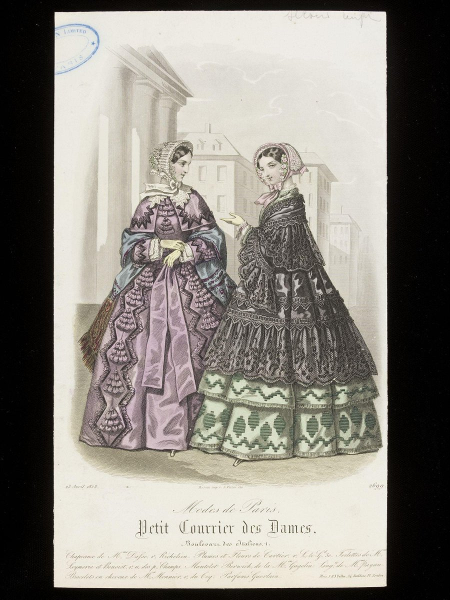 ©Victoria & Albert Museum, London - Two women in a city setting, one in a lilac dress with self coloured ruchings, tassels and matching capelet, with blue shawl, the other in a green flounced dress with a black mantle trimmed with deep lace flounces. Both in flower-trimmed bonnets.