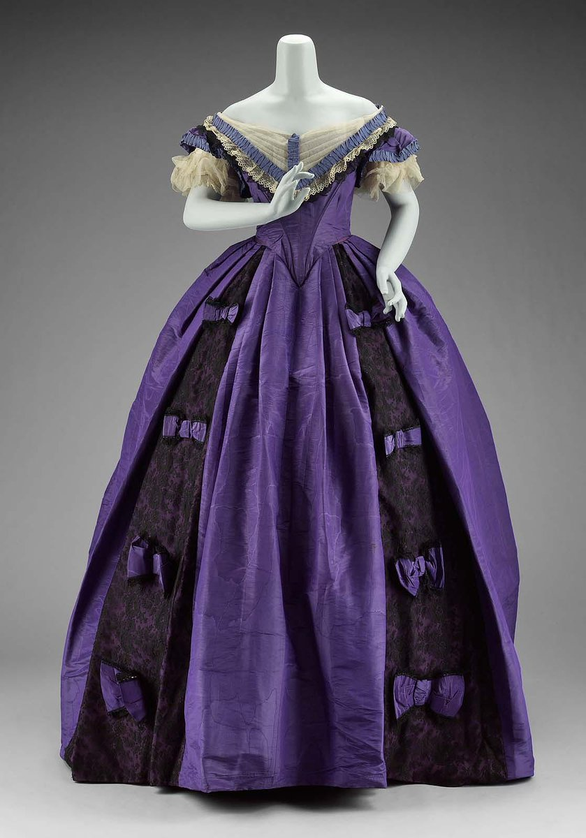 Royal purple moiré faille, boned evening bodice with tulle, lace, and periwinkle trim. Royal purple moiré faille day bodice trimmed with black silk bobbin lace and carnival glass buttons. Royal purple moiré faille, skirt trimmed with black chantilly lace and purple bows. 1860s, American. Boston MFA.