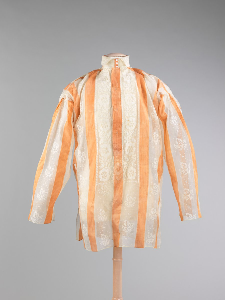 ca 1850. Met Museum. Orange and white striped shirt with subtle floral design. High collar, long sleeves.